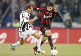 UDINE, ITALY - DECEMBER 23:   Damiano Zenoni #3 of Udinese and Yoann Gourcuff #20 of AC Milan in action at Stadio Friuli during a Match December 23, 2006 in Udine, Italy.  (Photo by New Press/Getty Images)