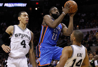 SAN ANTONIO, TX - MAY 27:  James Harden #13 of the Oklahoma City Thunder crashes into Gary Neal #14 of the San Antonio Spurs in the fourth quarter as Harden goes up for a shot in Game One of the Western Conference Finals of the 2012 NBA Playoffs at AT&T C