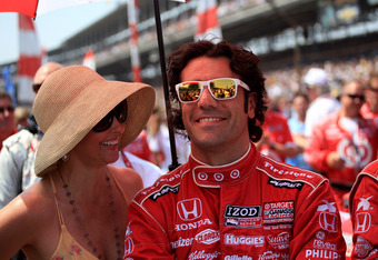 INDIANAPOLIS, IN - MAY 27:  Dario Franchitti of Scotland, driver of the #50 Target Chip Ganassi Racing Honda stands with his wife actress Ashley Judd prior to the start of the IZOD IndyCar Series 96th running of the Indianapolis 500 mile race at the India