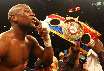 LAS VEGAS, NV - MAY 05:  Floyd Mayweather Jr. celebrates after defeating Miguel Cotto by unanimous decision during their WBA super welterweight title fight at the MGM Grand Garden Arena on May 5, 2012 in Las Vegas, Nevada.  (Photo by Al Bello/Getty Images