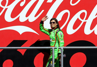 CONCORD, NC - MAY 27:  Danica Patrick, driver of the #10 GoDaddy.com Chevrolet, waves to the crowd during driver introductions prior to the start of the NASCAR Sprint Cup Series Coca-Cola 600 at Charlotte Motor Speedway on May 27, 2012 in Concord, North C