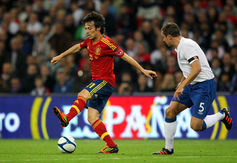 LONDON, ENGLAND - NOVEMBER 12:  David Silva of Spain is watched Phil Jagielka of England during the international friendly match between England and Spain at Wembley Stadium on November 12, 2011 in London, England.  (Photo by Alex Livesey/Getty Images)
