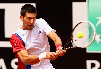 ROME, ITALY - MAY 21:  Novak Djokovic of Serbia in action against Rafael Nadal of Spain in their final match during day ten of the Internazionali BNL d'Italia 2012 at the Foro Italico Tennis Centre on May 21, 2012 in Rome, Italy.  (Photo by Clive Brunskil