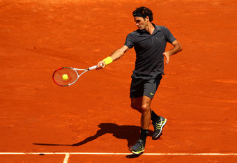 PARIS, FRANCE - MAY 28:  Roger Federer of Switzerland plays a forehand in the men's singles first round match between Roger Federer of Switzerland and Tobias Kamke of Germany during day two of the French Open at Roland Garros on May 28, 2012 in Paris, Fra