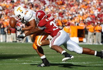 TUSCALOOSA, AL - OCTOBER 24:  Nico Johnson #35 of the Alabama Crimson Tide breaks up a pass intended for Shane Reveiz #45 of the Tennessee Volunteers at Bryant-Denny Stadium on October 24, 2009 in Tuscaloosa, Alabama.  (Photo by Kevin C. Cox/Getty Images)