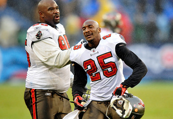 NASHVILLE, TN - NOVEMBER 27:  Albert Hanesworth #95 consoles Aqib Talib #25 of the Tampa Bay Buccaneers as Talib reacts after a teammate's game-ending fumble against the Tennessee Titans during play at LP Field on November 27, 2011 in Nashville, Tennessee