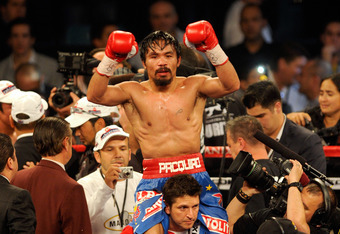 LAS VEGAS, NV - NOVEMBER 12:  Manny Pacquiao celebrates his majority decision victory against Juan Manuel Marquez in the WBO world welterweight title fight at the MGM Grand Garden Arena on November 12, 2011 in Las Vegas, Nevada.  (Photo by Ethan Miller/Ge