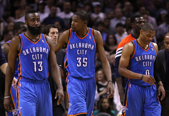 SAN ANTONIO, TX - MAY 27:  (L-R) James Harden #13, Kevin Durant #35 and Russell Westbrook #0 of the Oklahoma City Thunder walk off the court after losing 101-98 to the San Antonio Spurs in Game One of the Western Conference Finals of the 2012 NBA Playoffs