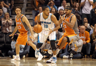 PHOENIX, AZ - DECEMBER 26:  Eric Gordon #10 of the New Orleans Hornets handles the ball during the season openning NBA game against the Phoenix Suns at US Airways Center on December 26, 2011 in Phoenix, Arizona.  The Hornets defeated the Suns 85-84. NOTE