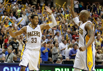 INDIANAPOLIS, IN - MAY 08: Danny Granger #33 of the Indiana Pacers celebrates a late fourth quarter three point basket with David West #21while playing the Orlando Magic in Game Five of the Eastern Conference Quarterfinals during the 2012 NBA Playoffs on