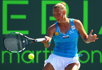 KEY BISCAYNE, FL - MARCH 24:  Yanina Wickmayer of Belguim in action against Kim Clijsters of Belguim during Day 6  at Crandon Park Tennis Center at the Sony Ericsson Open on March 24, 2012 in Key Biscayne, Florida.  (Photo by Al Bello/Getty Images)