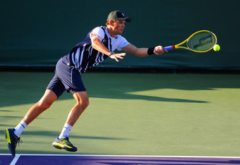 KEY BISCAYNE, FL - MARCH 29:  Bob Bryan of the USA plays a shot in his match with doubles partner Mike Bryan against Leander Paes of India and Radek Stepanek of the Czech Republic on day 11 of the Sony Ericsson Open at Crandon Park Tennis Center on March