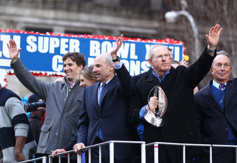 NEW YORK, NY - FEBRUARY 07:  Head Coach Tom Coughlin (2nd R) and Quarterback Eli Manning (L) of the New York Giants wave to the crowd during the New York Giants' ticker tape victory parade down the Canyon of Heros on February 7, 2012 in New York City.  Th