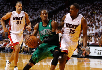 MIAMI, FL - MAY 28:  Rajon Rondo #9 of the Boston Celtics drives in the first half against Mario Chalmers #15 of the Miami Heat in Game One of the Eastern Conference Finals in the 2012 NBA Playoffs on May 28, 2012 at American Airlines Arena in Miami, Flor