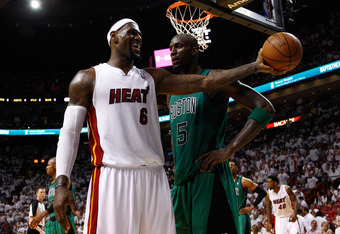 MIAMI, FL - MAY 28:  LeBron James #6 of the Miami Heat smiles as he holds out the ball in the second half against Kevin Garnett #5 of the Boston Celtics in Game One of the Eastern Conference Finals in the 2012 NBA Playoffs on May 28, 2012 at American Airl