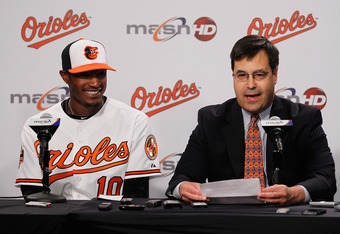 BALTIMORE, MD - MAY 27:  Adam Jones #10 of the Baltimore Orioles smiles while addressing the media with Dan Duquette, executive vice president of baseball operations for the team after announcing Jones had signed a six-year contract through the 2018 seaso