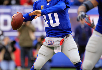 EAST RUTHERFORD, NJ - JANUARY 08:  Eli Manning #10 of the New York Giants throws a pass against the Atlanta Falcons during their NFC Wild Card Playoff game at MetLife Stadium on January 8, 2012 in East Rutherford, New Jersey.  (Photo by Chris Trotman/Gett
