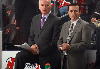 Adam Oates and Larry Robinson, both assistant coaches with New Jersey, should be considered for the vacancy behind the Caps' bench.