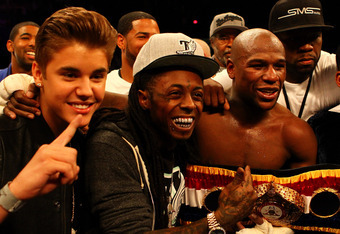 LAS VEGAS, NV - MAY 05:  Singer Justin Bieber, Rapper Lil Wayne, boxer Floyd Mayweather Jr. and rapper Curtis '50 Cent' Jackson pose after Mayweather Jr. defeats Miguel Cotto by unanimous decision in their WBA super welterweight title fight at the MGM Gra