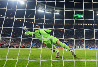 MUNICH, GERMANY - MAY 19:  Ashley Cole of Chelsea scores a penalty in the shoot out past Manuel Neuer of FC Bayern Muenchen during UEFA Champions League Final between FC Bayern Muenchen and Chelsea at the Fussball Arena München on May 19, 2012 in Munich,