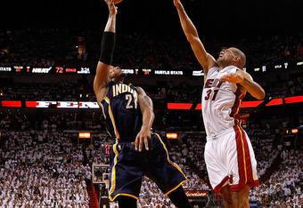 MIAMI, FL - MAY 15: David West #21 of the Indiana Pacers shoots over Shane Battier #31 of the Miami Heat during Game Two of the Eastern Conference Semifinals in the 2012 NBA Playoffs  at AmericanAirlines Arena on May 15, 2012 in Miami, Florida. NOTE TO US