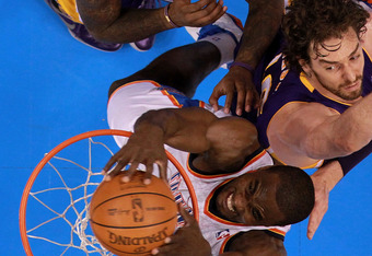 OKLAHOMA CITY, OK - MAY 21:  Serge Ibaka #9 of the Oklahoma City Thunder makes the slam dunk against Pau Gasol #16 and Jordan Hill #27 of the Los Angeles Lakers during Game Five of the Western Conference Semifinals of the 2012 NBA Playoffs at Chesapeake E