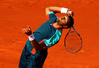 PARIS, FRANCE - MAY 27:  Jo-Wilfried Tsonga of France serves during the men's singles first round match between Andrey Kuznetsov of Russia and Jo-Wilfried Tsonga of France on day one of the French Open at Roland Garros on May 27, 2012 in Paris, France.  (