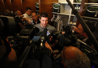 FLORHAM PARK, NJ - MAY 24:  Tim Tebow #15 of the New York Jets speaks to reporters after an organized team activity at the New York Jets Atlantic Health Jets Training Center on May 24, 2012 in Florham Park, New Jersey.  (Photo by Jeff Zelevansky/Getty Ima