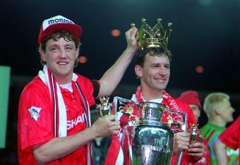Steve Bruce and Bryan Robson celebrate the 1993 Premier League title.
