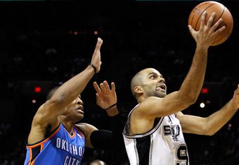 SAN ANTONIO, TX - MAY 29:  Tony Parker #9 of the San Antonio Spurs goes up for a shot in front of Russell Westbrook #0 of the Oklahoma City Thunder in the first quarter in Game Two of the Western Conference Finals of the 2012 NBA Playoffs at AT&T Center o