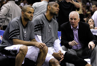 SAN ANTONIO, TX - MAY 29:  (R-L) Head coach Gregg Popovich of the San Antonio Spurs talks to Tim Duncan #21 and Tony Parker #9 on the bench in the third quarter while taking on the Oklahoma City Thunder in Game Two of the Western Conference Finals of the