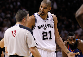 SAN ANTONIO, TX - MAY 29:  Tim Duncan #21 of the San Antonio Spurs argues a call with referee Monty McCutchen #13 while taking on the Oklahoma City Thunder in Game Two of the Western Conference Finals of the 2012 NBA Playoffs at AT&T Center on May 29, 201