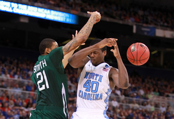 ST. LOUIS, MO - MARCH 23:  Harrison Barnes #40 of the North Carolina Tar Heels loses the ball in the second half as he is defended by Jon Smith #21 of the Ohio Bobcats during the 2012 NCAA Men's Basketball Midwest Regional Semifinal at Edward Jones Dome o