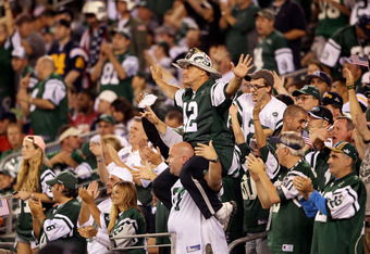 EAST RUTHERFORD, NJ - SEPTEMBER 11:  New York Jets fan Fireman Ed Anzalone leads the fans in cheers against the Dallas Cowboys during their NFL Season Opening Game at MetLife Stadium on September 11, 2011 in East Rutherford, New Jersey.  (Photo by Elsa/Ge
