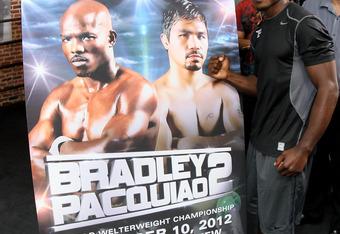 Timothy Bradley displaying Bradley vs. Pacquiao 2 poster