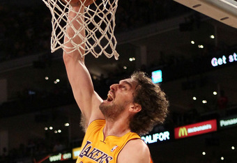 LOS ANGELES, CA - MAY 19:  Pau Gasol #16 of the Los Angeles Lakers dunks the ball in front of Russell Westbrook #0 of the Oklahoma City Thunder in the first quarter in Game Four of the Western Conference Semifinals in the 2012 NBA Playoffs on May 19 at St