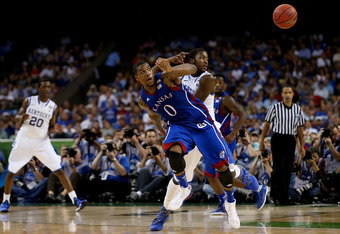 NEW ORLEANS, LA - APRIL 02:  Thomas Robinson #0 of the Kansas Jayhawks and Michael Kidd-Gilchrist #14 of the Kentucky Wildcats go after a loose ball in the first half in the National Championship Game of the 2012 NCAA Division I Men's Basketball Tournamen