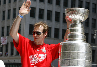 DETROIT - JUNE 06:  Nicklas Lidstrom #5 of the Detroit Red Wings waves to the crowd during a parade to celebrate winning the 2008 Stanley Cup on June 6, 2008 in Detroit, Michigan.  (Photo by Gregory Shamus/Getty Images)