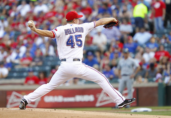 ARLINGTON, TX - MAY 30: Derek Holland #45 of the Texas Rangers pitches against the Seattle Mariners at Rangers Ballpark in Arlington on May 30, 2012 in Arlington, Texas. Holland gave up eight runs before being relieved in the second inning. (Photo by Rick