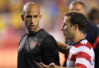 LANDOVER, MD - MAY 30: Goalie Tim Howard #1 (L) walks off the field with Steve Cherundolo #6 of USA after losing 4-1 to Brazil during an International friendly game at FedExField on May 30, 2012 in Landover, Maryland.  (Photo by Rob Carr/Getty Images)