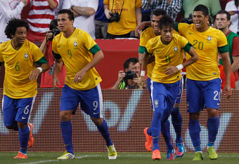 LANDOVER, MD - MAY 30: Neymar #11 of Brazil is congratulated by teammates after scoring a goal against USA during an International friendly game at FedExField on May 30, 2012 in Landover, Maryland.  (Photo by Rob Carr/Getty Images)