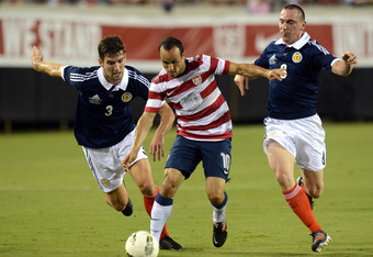 JACKSONVILLE, FL - MAY 26:  Landon Donovan #10 of Team USA , is defended by Charlie Mulgrew #3 and Scott Brown #8 of Team Scotland on May 26, 2012 at EverBank Field in Jacksonville, Florida. (Photo by Gary Bogdon/Getty Images)