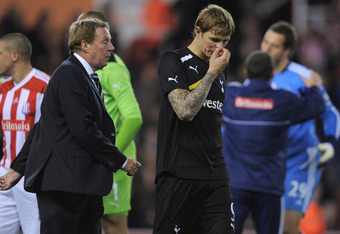 STOKE ON TRENT, ENGLAND - SEPTEMBER 20: Tottenham manager Harry Redknapp and Roman Pavlyuchenko look dejected after the Carling Cup Third Round match between Stoke City and Tottenham Hotspur at the Britannia Stadium on September 20, 2011 in Stoke on Trent