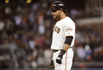 Melky stands at first after his record-tying hit.