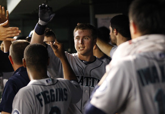 ARLINGTON, TX - MAY 30: Justin Smoak #17 of the Seattle Mariners is congratulated for hitting a home run in the fourth inning against the Texas Rangers at Rangers Ballpark in Arlington on May 30, 2012 in Arlington, Texas. (Photo by Rick Yeatts/Getty Image