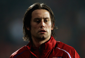 PODGORICA, MONTENEGRO - NOVEMBER 15:  Tomas Rosicky of Czech Republic warms up prior to the EURO 2012 Qualifier, Play Off Second Leg between Montenegro and the Czech Republic at the City Stadium on November 15, 2011 in Podgorica, Montenegro.  (Photo by Sc