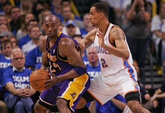 OKLAHOMA CITY, OK - MAY 16:  Kobe Bryant #24 of the Los Angeles Lakers looks to drive on Thabo Sefolosha #2 of the Oklahoma City Thunder in Game Two of the Western Conference Semifinals in the 2012 NBA Playoffs on May 16, 2012 at the Chesapeake Energy Are