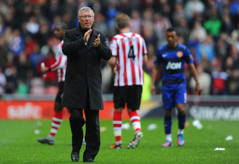 SUNDERLAND, ENGLAND - MAY 13:  Manchester United manager Sir Alex Ferguson looks dejected after the Barclays Premier League match between Sunderland and Manchester United at the Stadium of Light on May 13, 2012 in Sunderland, England.  (Photo by Michael R