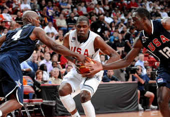 LAS VEGAS - JULY 24:  Chauncey Billups #4 and Jeff Green #12 of the 2010 USA Basketball Men's National Team try to stop Kevin Durant #5 of the 2010 USA Basketball Men's National Team during a USA Basketball showcase at the Thomas & Mack Center on July 24,