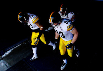 DENVER, CO - JANUARY 08:  Weslye Saunders #82, David Johnson #85 and Heath Miller #83 of the Pittsburgh Steelers enter the field prior to the start of their AFC Wild Card Playoff game against the Denver Broncos at Sports Authority Field at Mile High on Ja